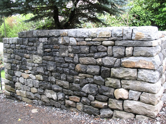 6' freestanding wall.  Dry stone construction. Solid cap.